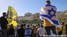 Fans of Israeli Beitar Jerusalem football club show their support during the team's training in Jerusalem on December 11, 2020, after a member of Abu Dhabi's royal family bought half of Beitar. - The agreement comes after Israel established ties with UAE and Bahrain, only the third and fourth only Arab nations to normalise relations with the Jewish state after Egypt and Jordan. Beitar Jerusalem's fans have historically been considered anti-Muslim and anti-Arab, with their far-right La Familia fan group known for its chants against the Prophet Mohammed. The first division club is the only Israeli side never to have fielded an Arab player. (Photo by Emmanuel DUNAND / AFP)