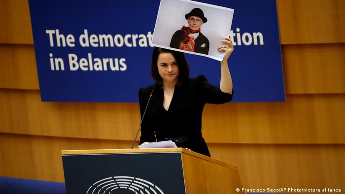 Belarusian opposition leader Sviatlana Tsikhanouskaya holds a picture of activist Nina Baginskaja during the EU Parliament's Sakharov Prize ceremony on December 16, 2020