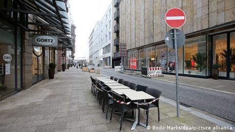 Tables and chairs stand empty in downtown Hamburg