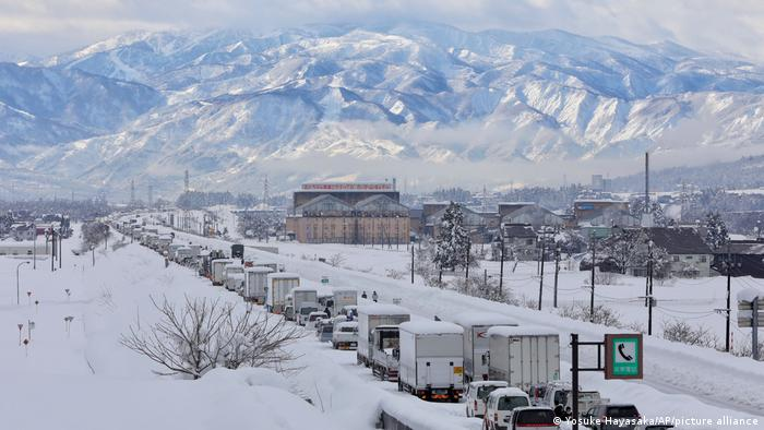 Vehicles stuck on Friday in Japan's Niigata prefecture