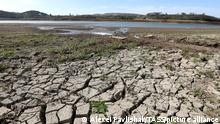 SIMFEROPOL, CRIMEA, RUSSIA - OCTOBER 17, 2020: A view of the dried out bottom of the Simferopol Reservoir going low due to a drought. On September 7, 2020, the third stage of water supply limitations started in Simferopol and 39 locations of Simferopol and Bakhchisaray Districts amid the shallowing of three reservoirs, the Ayanskoe, the Partizanskoye, and the Simferopolskoye. The areas are supplied with drinking water in the morning and in the evening according to a schedule. On September 23, a water supply schedule was also implemented in Alushta, the villages of Partenit and Maly Mayak due to the shallowing of the Izobilnenskoye reservoir. Alexei Pavlishak/TASS