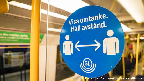A sign on public transport in Sweden reminding people to maintain social distancing