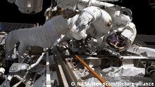 NASA astronaut Andrew Morgan is pictured on November 22, 2019, while tethered to the Starboard-3 truss segment work site during the second spacewalk to repair the International Space Station's cosmic particle detector, the Alpha Magnetic Spectrometer. During the 6.5 hour spacewalk, Morgan and Station Commander Luca Parmitano of the European Space Agency, successfully cut eight stainless steel tubes, including one that vented the remaining carbon dioxide from the old cooling pump. The crew members also prepared a power cable and installed a mechanical attachment device in advance of installing the new cooling system. This work clears the way for Parmitano and Morgan's next spacewalk in the repair series on December 2, 2019. The plan is to bypass the old thermal control system by attaching a new one off the side of AMS during the third spacewalk and then conduct leak checks on a fourth spacewalk. NASA/UPI Photo via Newscom picture alliance