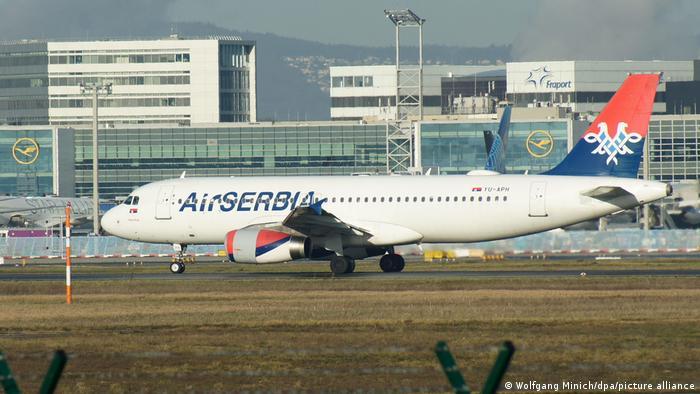 An Air Serbia plane landing in Frankurt Airport