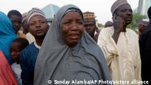 Dec. 18, 2020*** A family member of a freed schoolboy cries as she waits for a reunion with her son in Katsina Nigeria Friday Dec. 18, 2020. More than 300 schoolboys kidnapped last week in an attack on their school in northwest Nigeria have arrived in the capital of Katsina state to celebrate their release. The boys were abducted one week ago from the all-boys Government Science Secondary School in Kankara in Katsina state village. (AP Photo/Sunday Alamba)