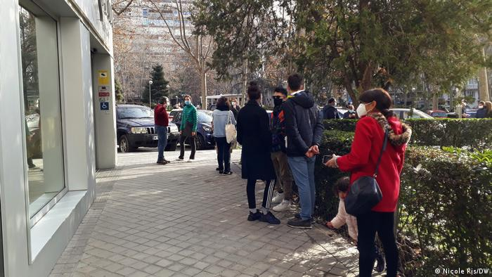 People wait in line for a COVID test in Madrid