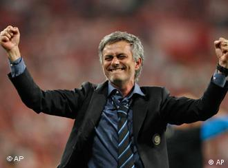 Inter Milan coach Jose Mourinho celebrates the 2-0 win in the Champions League final soccer match between Bayern Munich and Inter Milan at the Santiago Bernabeu stadium in Madrid, Saturday May 22, 2010.