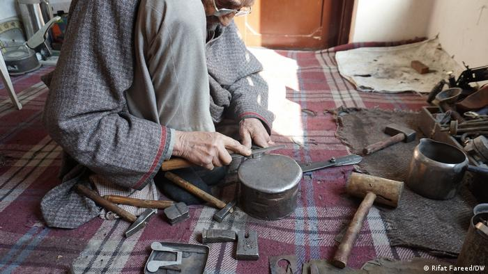 During the reign of Maharaja Hari Singh when Kashmir was a kingdom in the 1940s, Germans manufactured medical equipment. Mohiuddin's family members could repair the German-made equipment perfectly, and impressed German craftsmen at the time. Singh named the craftsmen German Khars (blacksmiths) for their expertise in repairing the equipment, which no one else could do in Kashmir.