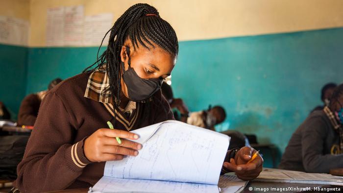 Girl wears a mask at school in Lusaka, Zambia