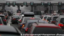 Motorists wait to cross the Serbian border from Croatia, at Batrovci border crossing, Serbia, Sunday, Dec. 20, 2020. Balkan citizens leaving Western Europe to go home for the holidays created huge traffic jams at border crossings Saturday despite coronavirus restrictions that seek to discourage travel over Christmas and New Year. (AP Photo/Darko Vojinovic)
