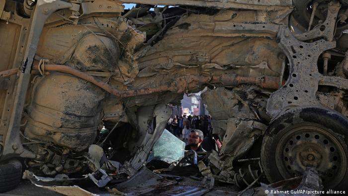 The charred remains of a vehicle hit by a roadside bomb in Kabul in December 2020