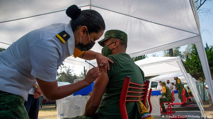 Medical personnel injects the vaccine to a military personnel in Mexico