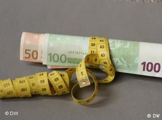 Euro notes wrapped in a tape measure
