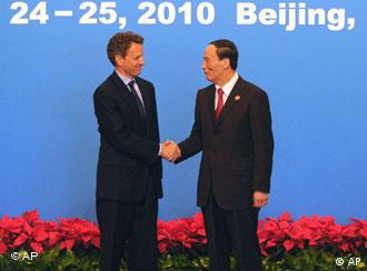 US Treasury Secretary Timothy Geithner, left, is greeted by Chinese Vice Premier Wang Qishan