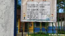 21.12.2020 Die am Schultor hinterlassene Nachricht fordert die Schüler und Schülerinnen auf, die letzten Aktivitäten durchzuführen.