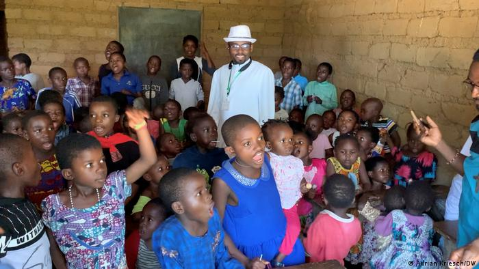 Pastor Roland Arrey in a youth center with Cameroonian children