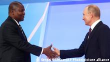 Russian President Vladimir Putin, right, shakes with President of the Central African Republic Faustin Archange Touadera during a welcome ceremony of the Russia-Africa summit in the Black Sea resort of Sochi, Russia, Wednesday, Oct. 23, 2019. (AP Photo/Sergei Chirikov, pool photo via AP)