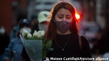 A woman marches against gender violence in downtown Guatemala City, Tuesday, Dec. 22, 2020. Protesters marched from the attorney general's headquarters to Constitution Square demanding the investigation of murders and disappearances of women across the country. (AP Photo/Moises Castillo)