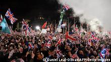 TOPSHOT - Brexit supporters wave Union flags as the time reaches 11 O'Clock, in Parliament Square, venue for the Leave Means Leave Brexit Celebration in central London on January 31, 2020, the day that the UK formally leaves the European Union. - Brexit supporters gathered outside parliament on Friday to cheer Britain's departure from the European Union following three years of epic political drama -- but for others there were only tears. After 47 years in the European fold, the country leaves the EU at 11:00pm (2300 GMT) on Friday, with a handful of the most enthusiastic supporters gathering opposite the Houses of Parliament 12 hours before the final countdown. (Photo by DANIEL LEAL-OLIVAS / AFP) (Photo by DANIEL LEAL-OLIVAS/AFP via Getty Images)