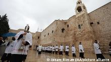 BETHLEHEM, WEST BANK - DECEMBER 24: Priests arrive at Church of Nativity, believed as the birthplace of Jesus, under measures taken against the coronavirus (Covid-19) pandemic, ahead of the night ritual as Christmas celebrations begin in Bethlehem, West Bank on December 24, 2020. Issam Rimawi / Anadolu Agency