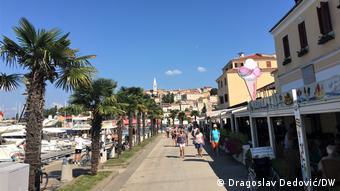 Tourists on promenade in Croatia