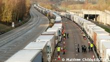 Lorries queue on the M20 motorway to enter the Port of Dover following the coronavirus disease (COVID-19) outbreak, near Ashford, Britain, December 24, 2020. REUTERS/Matthew Childs