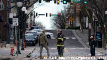 Emergency personnel work at the scene of an explosion in downtown Nashville, Tenn., Friday, Dec. 25, 2020. Buildings shook in the immediate area and beyond after a loud boom was heard early Christmas morning.(AP Photo/Mark Humphrey)