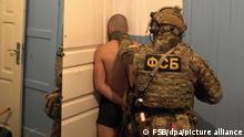 6428841 26.12.2020 In this handout video grab released by the Federal Security Service (FSB), Russia's FSB security service officers detained four operatives of the Islamic State (terror group, banned in Russia) and foiled plans to carry out acts of terror, in Mahachkala, Republic of Dagestan, Russia. The group had planned to set up an explosive device at an administrative building in the city and carry out armed attacks against police officers. A cache of weapons and evidence of foreign coordination of activities was found. Editorial use only, no archive, no commercial use. Federal Security Service of the Russian Federation