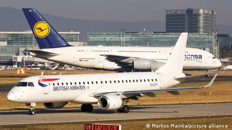 British airways and Lufthansa planes cross paths in Frankfurt's airport