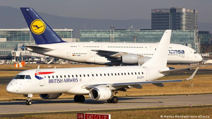 British airways and Lufthansa planes cross paths in Frankfurt's airport