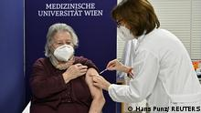 An elderly woman receives the first Pfizer/BioNTech COVID-19 vaccine at the MedUni Wien in Vienna