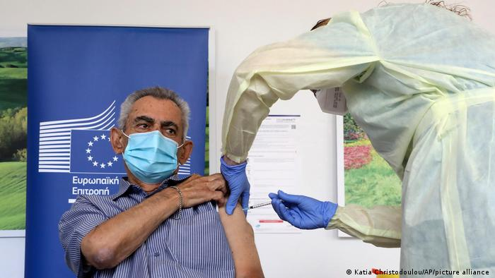 Andreas Raounas, 84, becomes the first patient on the island of Cyprus to receive the coronavirus vaccine.