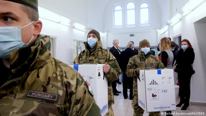 Hungarian soldiers carry the first shipment of Pfizer-BioNTech coronavirus disease (COVID-19) vaccines at the Del-Pest Central Hospital in Budapest