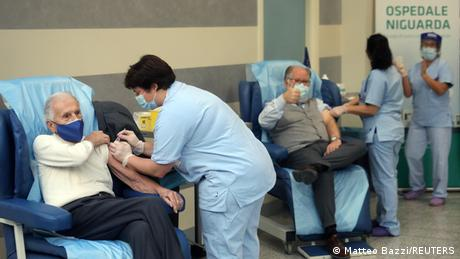 People receive the Pfizer/BioNTech COVID-19 vaccine at the Niguarda hospital in Milan