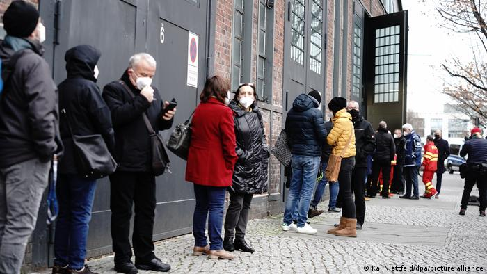 People wait in line for the COVID-19 vaccine in Berlin