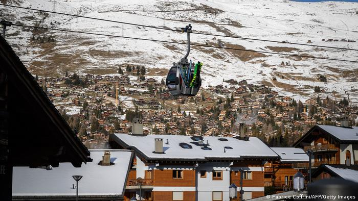 A helicopter flies over the Swiss ski resort of Verbier