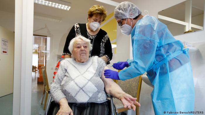 Elderly woman Ruth Heise receives a covid-19 jab