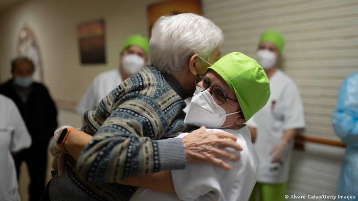 A health worker hugging a patient