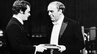 Nobel Prize winner in literature West German writer Heinrich Boll receives his award from Swedish Crown Prince Carl XVI Gustaf, in Stockholm on Sunday, Dec. 10, 1972 in Sweden. (AP Photo)