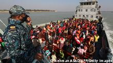 29.12.2020 *** Rohingya refugees sit on a Bangladesh Navy ship as they are relocated to the controversial flood-prone island Bhashan Char in the Bay of Bengal, in Chittagong on December 29, 2020. (Photo by Rehman ASAD / AFP) (Photo by REHMAN ASAD/AFP via Getty Images)
