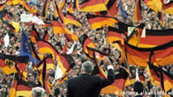 Former German Chancellor Helmut Kohl waving to crowd