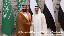 In this Wednesday, Nov. 27, 2019, photo released by Ministry of Presidential Affairs, Saudi Crown Prince Mohammed bin Salman, left, shakes hands with Abu Dhabi Crown Prince Mohammed bin Zayed Al Nahyan at Qasr Al Watan in Abu Dhabi, United Arab Emirates. Saudi crown prince is in the United Arab Emirates for talks that are expected to focus on the war in Yemen and tensions with Iran. (Rashed Al Mansoori/Ministry of Presidential Affairs via AP)
