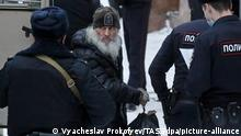MOSCOW, RUSSIA - DECEMBER 29, 2020: Unordained schema hegumen Sergius (Nikolai Romanov) is taken for a hearing at Moscow's Basmanny District Court. He was arrested at the Sredneuralsk Convent and sent to Moscow on 29 December after posting a video on YouTube encouraging his followers to die for Russia. Unordained schema hegumen Sergius (Nikolai Romanov) is charged with unsanctioned actions, encouraging people to kill themselves, and insulting religious feelings. He was excommunicated in May 2020 for violating a ban on preaching after calling on people to go to church despite the lockdown, describing the coronavirus situation as a fake pandemic. More recently, Sergius was stripped of his rank by the Yekaterinburg Eparchy court and ordered to leave the convent, but continued to perform church services nevertheless. The metropolitanate considers his actions an illegal seizure. Vyacheslav Prokofyev/TASS