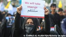 TOPSHOT - An Iraqi woman holds a placard during the funeral of Iranian military commander Qasem Soleimani, Iraqi paramilitary chief Abu Mahdi al-Muhandis and eight others in Baghdad's district of al-Jadriya, in Baghdad's high-security Green Zone, on January 4, 2020. - Thousands of Iraqis chanting Death to America joined the funeral procession for Iranian commander Qassem Soleimani and Iraqi paramilitary chief Abu Mahdi al-Muhandis, both killed in a US air strike. The cortege set off around Kadhimiya, a Shiite pilgrimage district of Baghdad, before heading to the Green Zone government and diplomatic district where a state funeral was to be held attended by top dignitaries. In all, 10 people -- five Iraqis and five Iranians -- were killed in Friday morning's US strike on their motorcade just outside Baghdad airport. (Photo by AHMAD AL-RUBAYE / AFP) (Photo by AHMAD AL-RUBAYE/AFP via Getty Images)