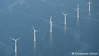 A row of windmills planted in the North Sea