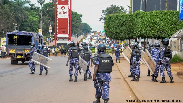 Security forces block the street leading to the Electoral Commission during a visit by Ugandan opposition presidential candidate Bobi Wine in Kampala
