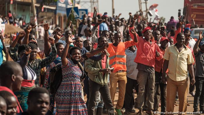 Supporters of Ugandan musician-turned-politician Robert Kyagulanyi, also known as Bobi Wine, welcome him on the streets as he sets off on his campaign trail towards eastern Uganda
