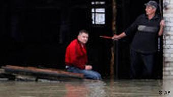 People wait for help in a flooded area on the outskirts of the town of Iuliszew, near Plock, in Poland
