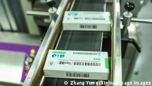 201230 -- BEIJING, Dec. 30, 2020 -- COVID-19 inactivated vaccine products are packaged at a packaging plant of the Beijing Biological Products Institute Co., Ltd. in Beijing, capital of China, Dec. 25, 2020. A Chinese inactivated vaccine shows 79.34 percent efficacy against COVID-19, according to the interim results of the phase-3 clinical trials unveiled by its developer Wednesday. The inactivated vaccine is developed by the Beijing Biological Products Institute Co., Ltd. under the China National Biotec Group CNBG, which is affiliated with Sinopharm. After a two-dose inoculation procedure, the vaccine receivers all produced high titers of antibodies, and the seroconversion rate of neutralizing antibodies reached 99.52 percent. The res PUBLICATIONxNOTxINxCHN