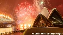 The Sydney Harbor fireworks display behind the city's famed opera house